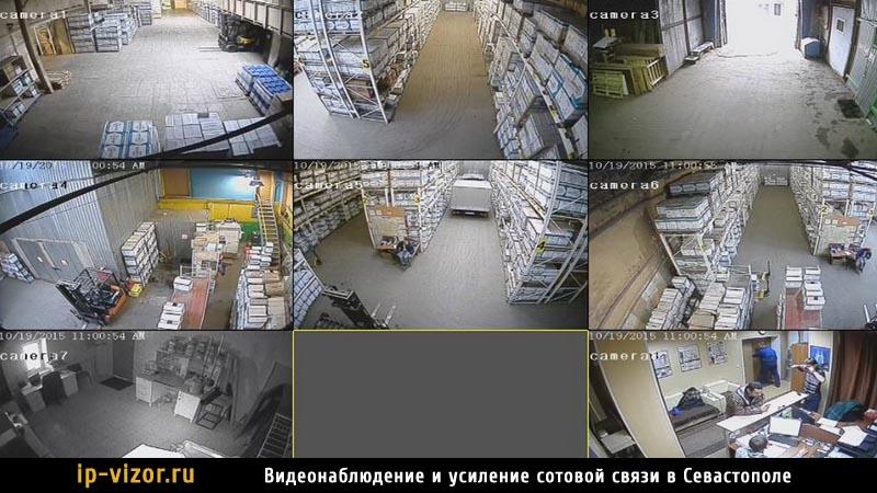 Вид с камер системы видеонаблюдения на складе предприятия